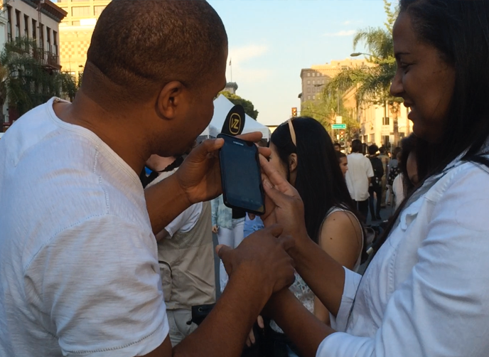 At the Make Music Pasadena photo banners strangers takes shots of each other