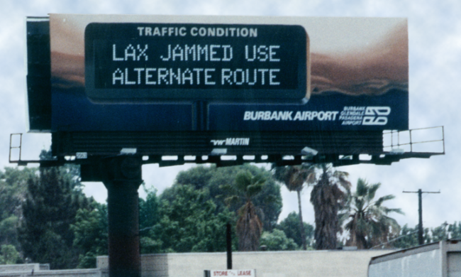 Original campaign billboard: LAX JAMMED USE ALTERNATE ROUTE